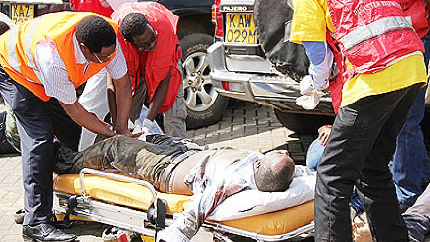 Medics attend to a wounded man outside the Westgate shopping mall in Nairobi, Kenya, Sept. 21, 2013. Net photo.