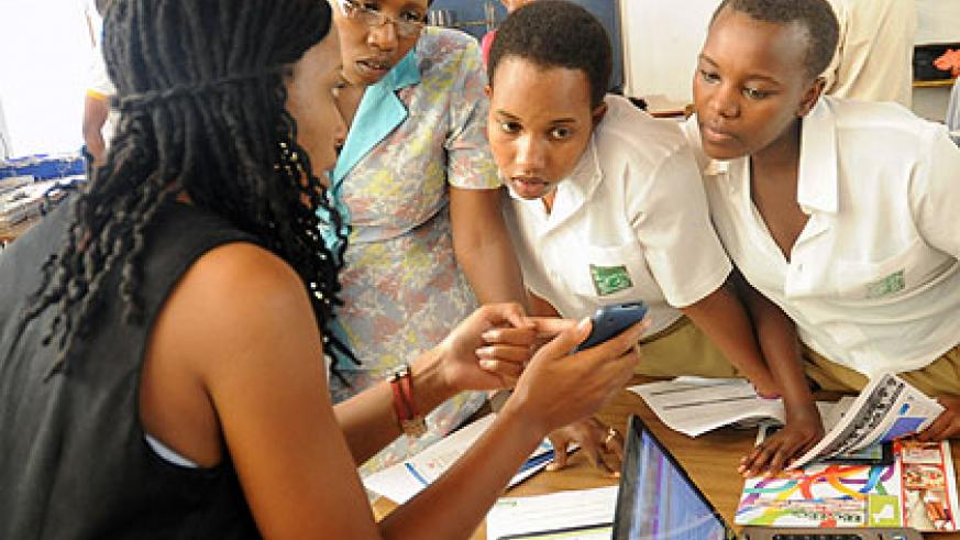 HeHe CEO  Clarisse Iribagiza (L) says Girls in ICT Day'  has helped in driving girls to embrace ICT careers.  The New Times/ File.