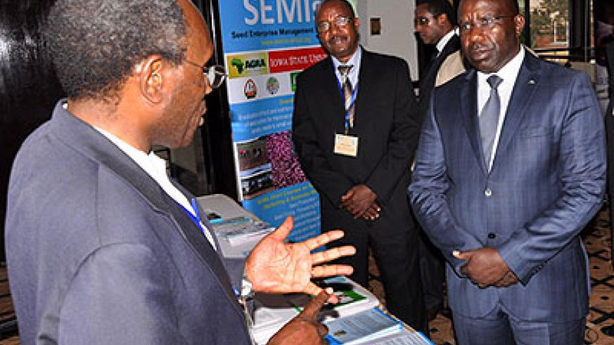 Prime Minister Pierre Damien Habumuremyi (R) listens to a participant from Nairobi University. The New Times, John Mbanda