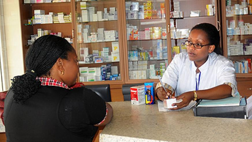 A pharmacist attends to a client. All practitioners will now be required to pass an exam set by the National Pharmacy Council before they can operate.  Saturday Times/File.