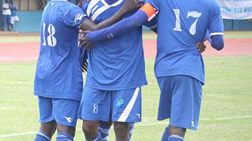 Djamal Mwiseneza (C) celebrates with team mates after putting Rayon Sports ahead yesterday. Sunday Sport/ P. Muzegeye.