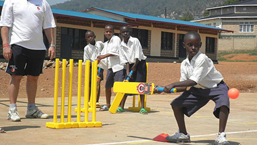 A kid tries to bat during a CWB training last year. Nine members of the UK-based charity organization returned to Rwanda on Sunday. Times Sport / Courtesy.