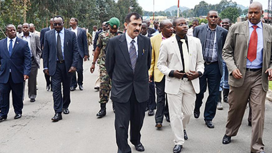 Northern Provice Governor Aime Bosenibamwe (L), Kanimba (2nd L) and other officials during the tour of Cyanika border-post in Burera District yesterday. The New Times/ Jean Mbonyinshuti.