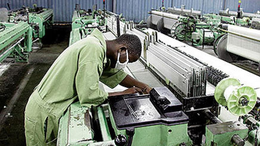 A textile worker checks equipment. EAC is seeking to have a harmonised industrial policy. File photo