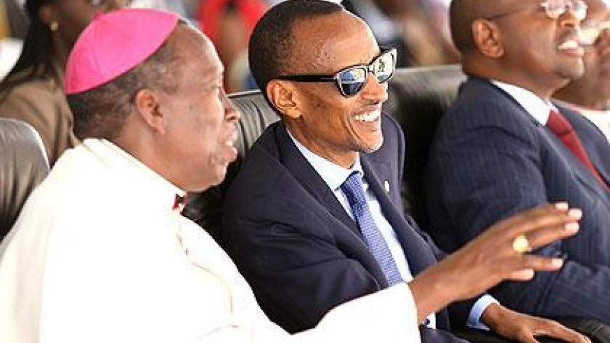 President Kagame listening to  Monsignor Smaragde Mbonyintege during the celebrations yesterday. Right is Local Government Minister James Musoni. The New TImes/Village Urugwiro