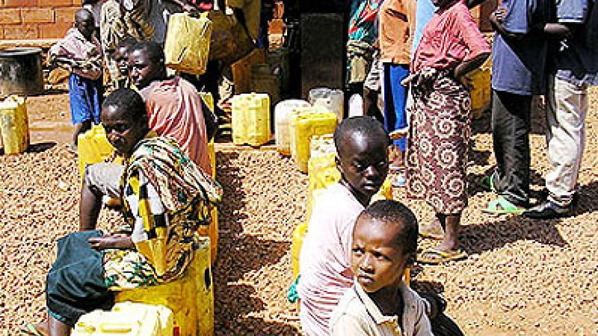 Some city residents at times spend hours queueing to access water. The New Times / File photo