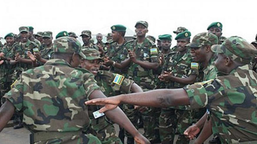 RDF soldiers dance during a past event. The liberation struggle is credited for Rwanda's rebirth. The New Times /File.