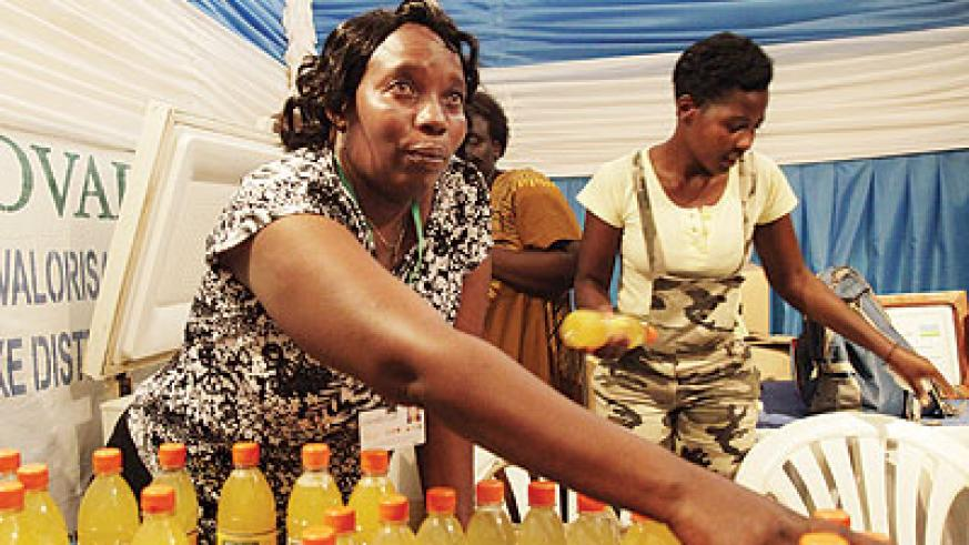 A juice maker displays her products at a trade fair. EADB is going to fund such business women