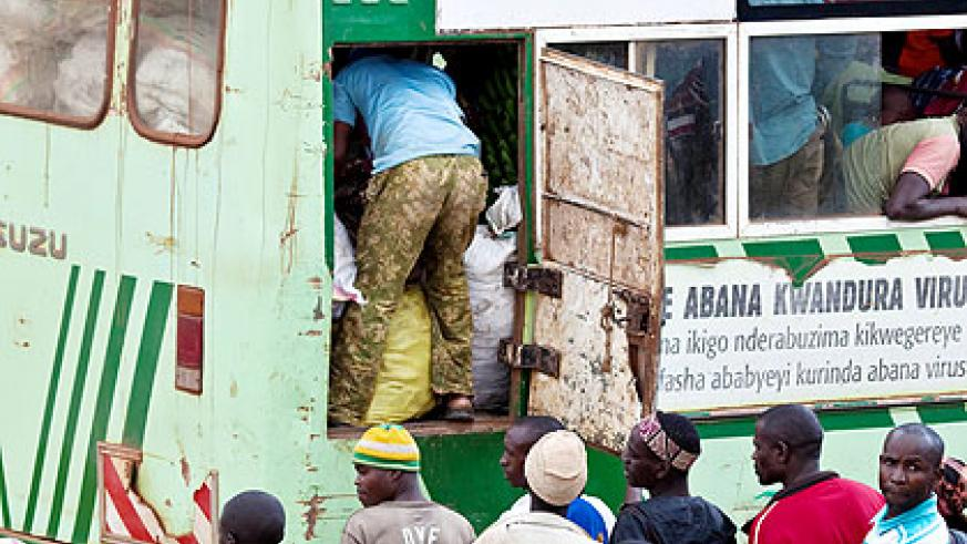 Travellers watch as their luggage are loaded on to an Onatracom bus. The Ministry of Infrastructure is set to scrutinise proposals of Seven Solutions Ltd, KPMG International and SM....