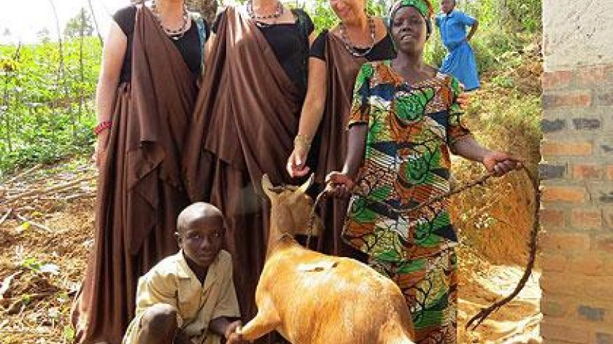 Henriette Uwineza receives a goat from the leaders of Young People for Africa. Sunday Times/Susan Babijja