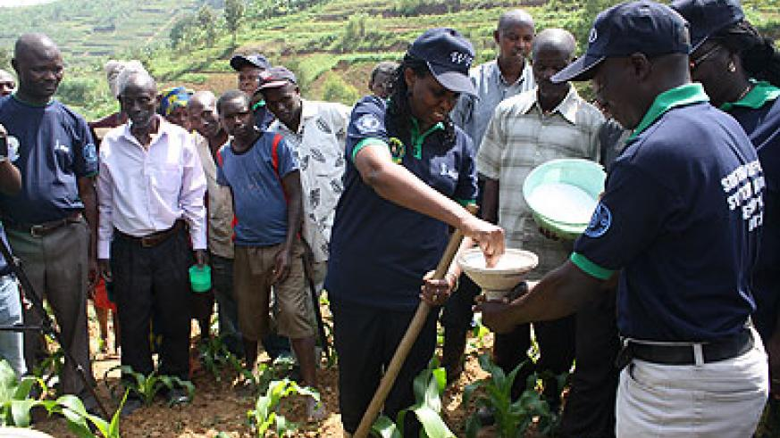 Minister Kalibata with some farmers during the World Food Day on Friday in Ngororero District.   The New Times/ Susan Babijja.