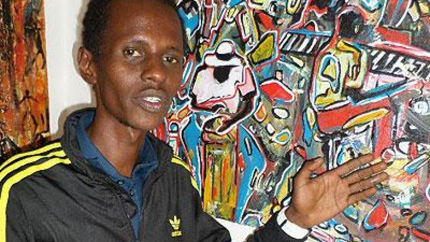 Tony Cyizanye explaining features of an art piece. Sunday Times/Ivan Ngoboka