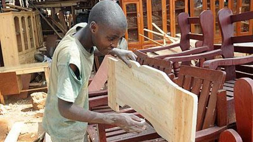 A young man at work in Gakinjiro. The New Times/Timothy Kisambira