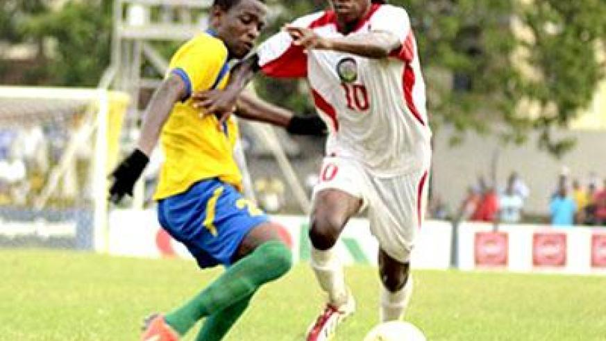 Amavubi defender Michel Rusheshangoga attempts to stop Kenya's Francis Kahata during yesterday's quarter final match played in Mombasa. Sunday Sports/Courtesy