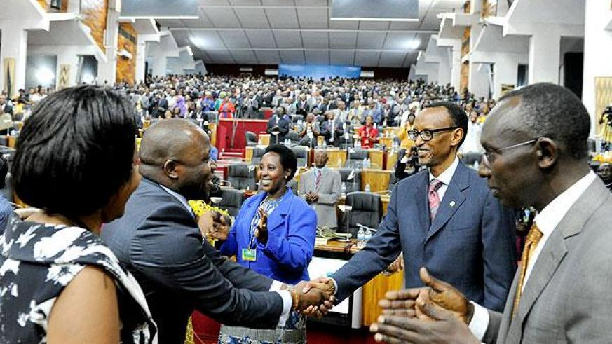 President Kagame greets some of the participants during the Dialogue.