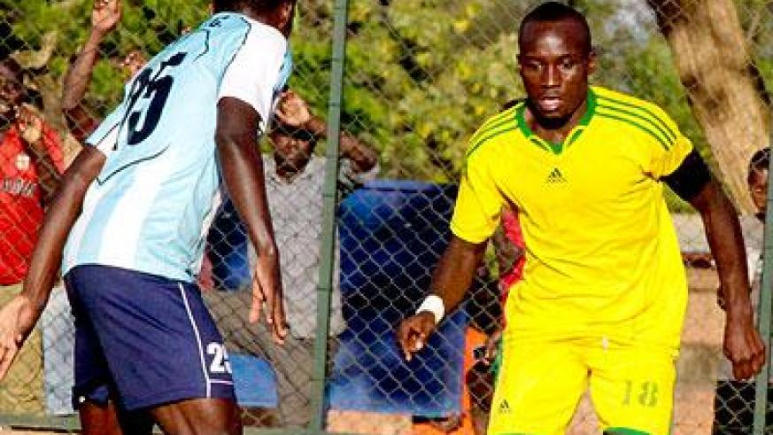 AS Kigali captain Jimmy Mbaraga (right) is touch and go for Sunday game against Kiyovu after missing training for two days with malaria. Sunday Sport/T. Kisambira