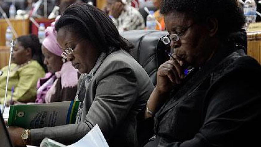 MPs read through the Ombudsman's report . The New Times/John Mbanda