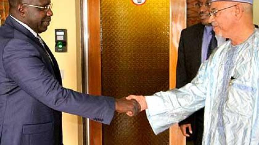 Niger's finance minister, Gilles Baillet (R), with Prime Minister Pierre-Damien Habumuremyi. Sunday Times/Courtesy