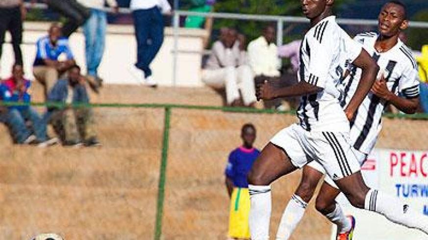 Both Andrew Buteera, front, and Jean-Baptiste Mugiraneza, in background, were on target for the league leaders. Sunday Sport/File