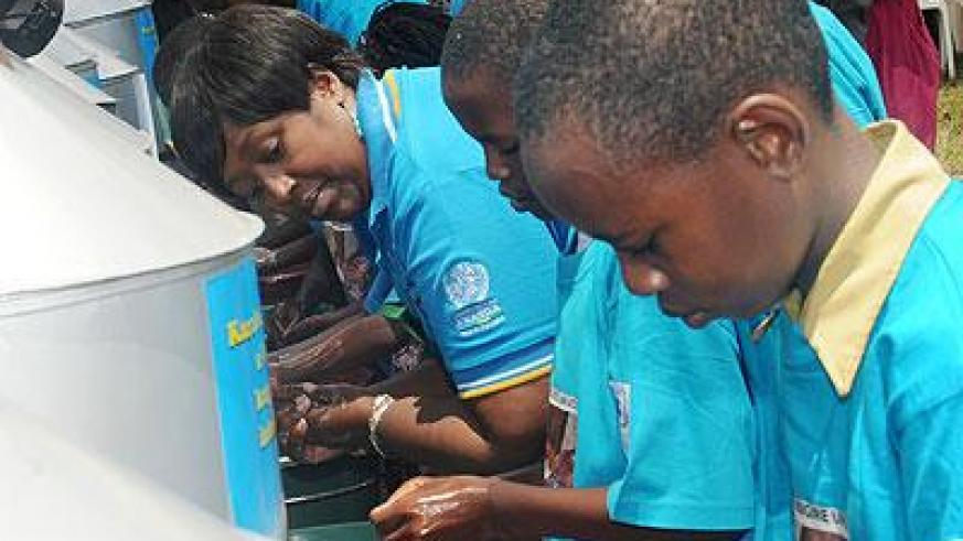 The Minister for Health, Dr Agnes Binagwaho and students wash hands during a hygiene campaign. Sunday Times/File
