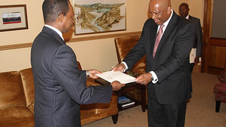 Amb. Karega (L) presenting his credentias to the King of Lesotho. Sunday Times/Courtesy