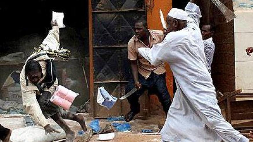 A shopkeeper (right) fights off looters with a machete in Bangui recently. Sunday Times/Internet photo