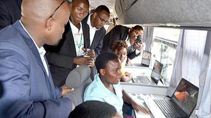 Minister Nsengimana with some of the residents of Rubavu who said that they were touching computers for the first time. Sunday Times/Jean d'Amour Mbonyinshuti