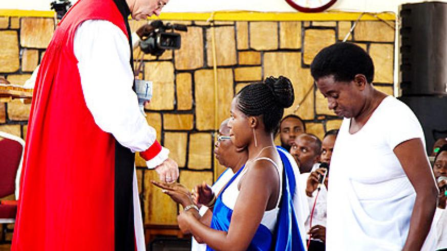 Archbishop Welby conducts Holy Communion at St. Etienne Anglican Church of Rwanda in Kigali yesterday. The New Times/ Timothy Kisambira.