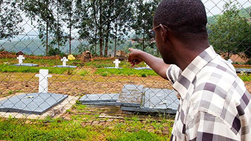 Innocent Kamanzi suspects his family was buried in this Ngororero District site. The New Times/ T. Kisambira.
