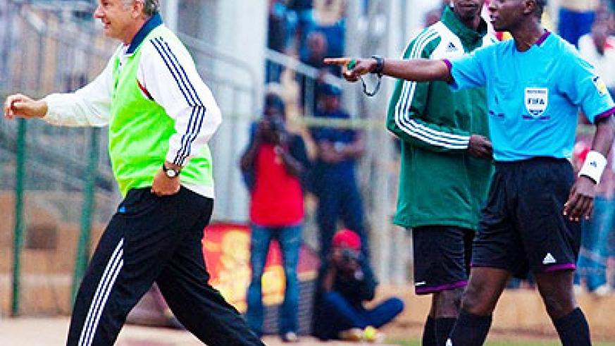 Andreas Spier (L) is directed to the stands by referee Hudu Munyemana following a confrotation with match officials on Saturday at Stade de Kigali. Times Sport/T. Kisambira.