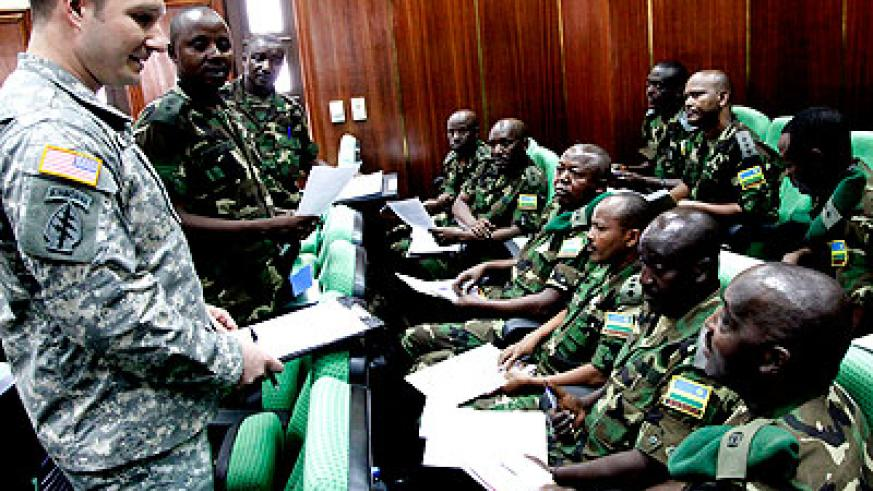 A US Army officer addresses RDF soldiers during a discussion yesterday. The New Times/ John Mbanda.
