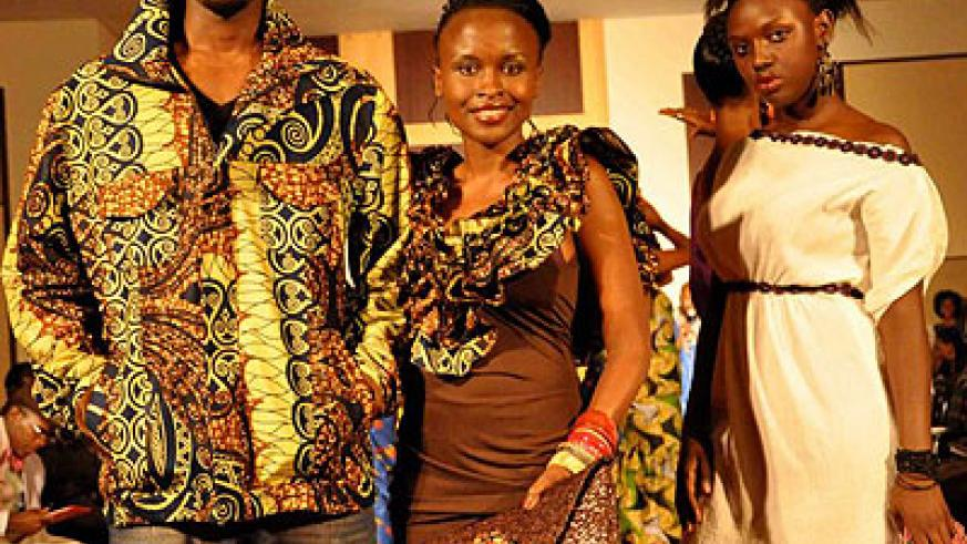 Joselyne Umutoniwase (centre) at one of the fashion shows organised by Rwanda clothing. The New Times / File.
