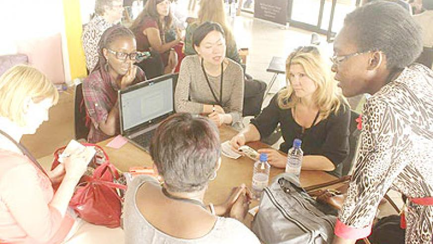 Women representatives from Silicon Valley discuss with girls active in ICT at the seminar. The New Times/ C. Mwai.