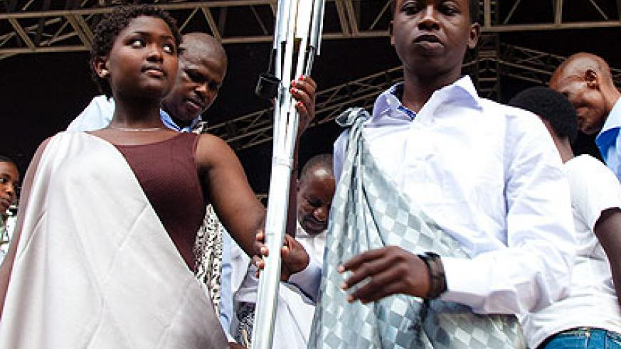 20-year-old youth carry the Kwibuka Flame. The flame is on a country wide tour. File.