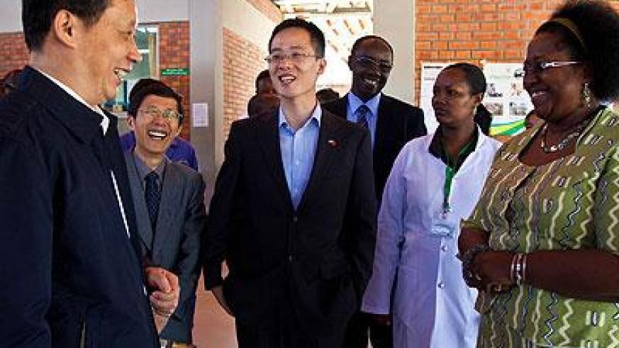 A Chinese official shares a light moment with Rwanda health minister Dr. Agnes Binagwaho (right) during a visit to Masaka Hospital. The health facility is one of the projects funde....
