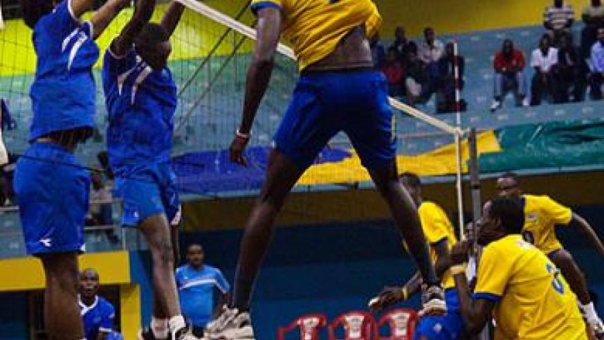 National team's Flavien Ndamukunda #12, goes up for a spike against Rayon Sports during Friday's build-up match, which Bitok's team won 3-0. Timothy Kisambira.