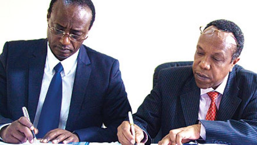 <p>Prof. Manasseh Nshuti (L), one of the founders of University of Kigali, and Dr. George Njenga, the vice-chancellor and dean of Strathmore Business School sign a memorandum of un....