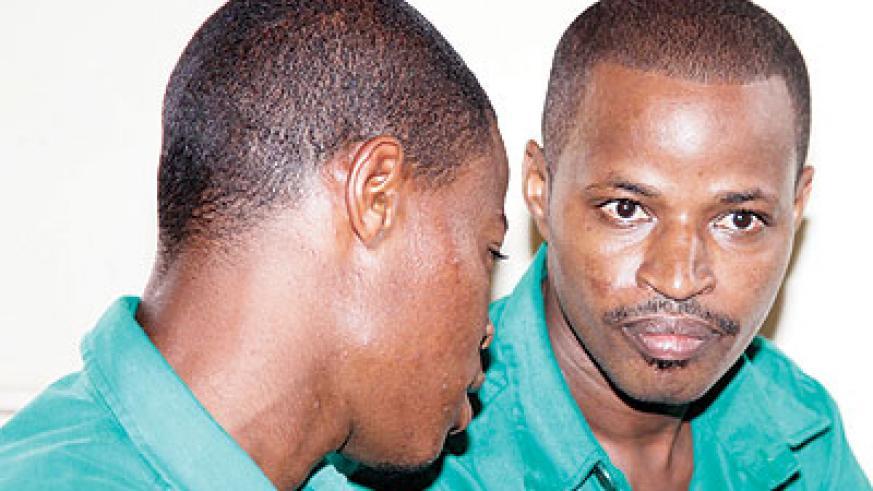 Joel Mutabazi (R) with his brother Jackson Karemera in court. Mutabazi as with Nshimiyimana decided to maintain silence in court and he refused to stand trial. File.