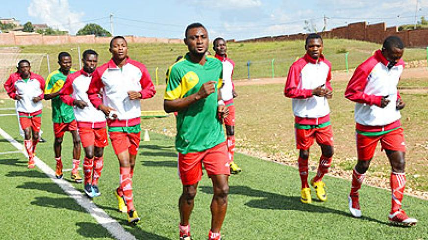Former Amavubi striker Saidi Abdi (front) leads his teammates in a pre-match warm-up session before a previous league game. Espoir are third in the league. Samuel Ngendahimana.