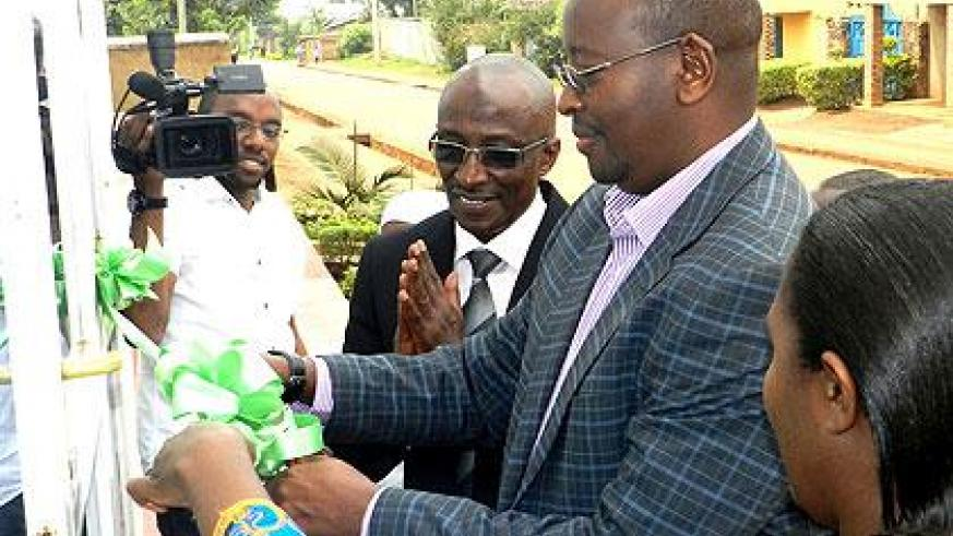 Minister James Musoni cutting a ribbon at the inauguration. Stephen Rwembeho