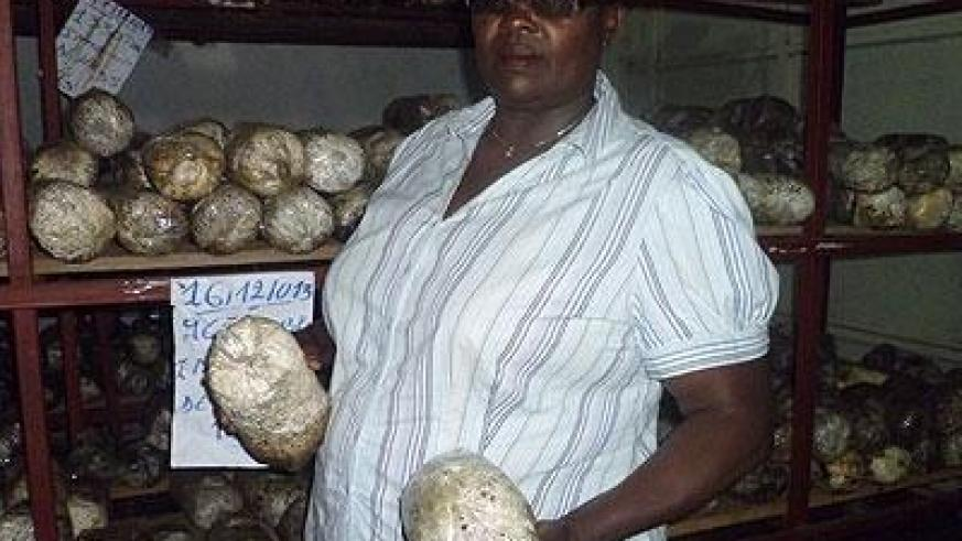 Niyibaho in one of her mushroom shops. After eight years of growing mushrooms, she is proud of her achievements. Seraphine Habimana