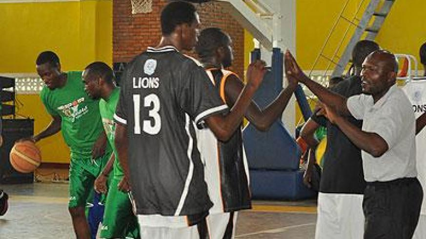 APR's Kenyan coach Cliff Owuor, right, gives hi-fives to his players before the start of Game Three of the 2012 Playoffs game against Espoir. File