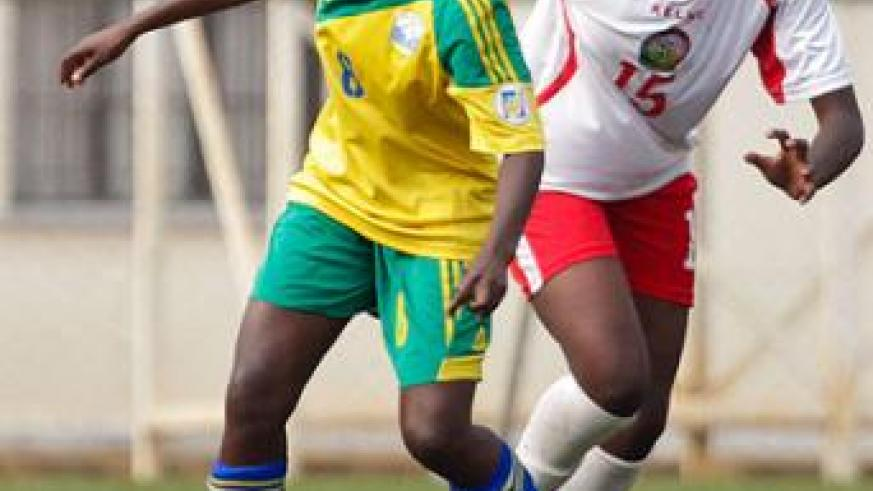 Striker Chadia Uwamahirwe dribbles past Kenya's Doris Anyango in the first leg of the Africa women championship first round match played at Stade de Kigali yesterday.  T. Kisambira.