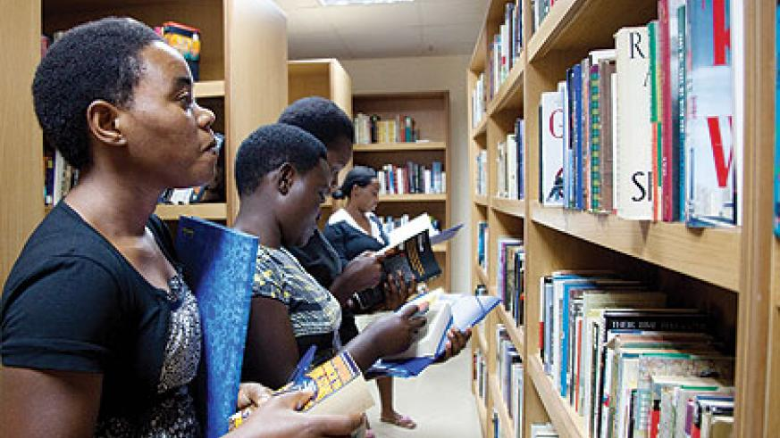 Students checking through books at Kigali Public Library. Senate has approved a Bill setting up  Rwandan Archives and Library Authority.   T.Kisambira
