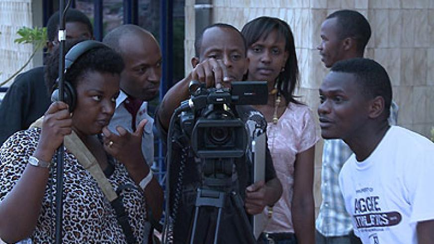 Jerome Mugabo prepares for shooting work with other youths. Courtesy.