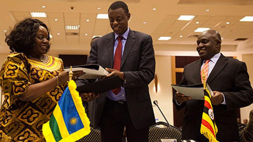 Defence ministers; Raychelle Omamo of Kenya, Rwanda's James Kabarebe and Crispus Kiyonga of Uganda after signing a defence pact in Kigali last month. File.