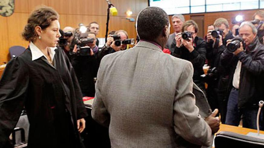 Rwabukombe (in grey) is photographed by journalists as he awaits court ruling in Frankfurt yesterday.  Net photo.