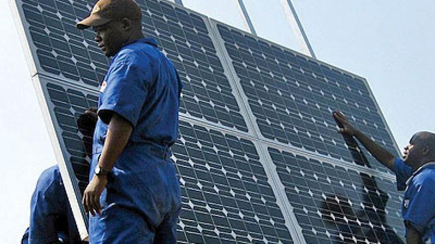 Technicians installing solar panels. Rwanda to  get 8.5MW of power from a new solar plant being set up by private investors. Net photo.