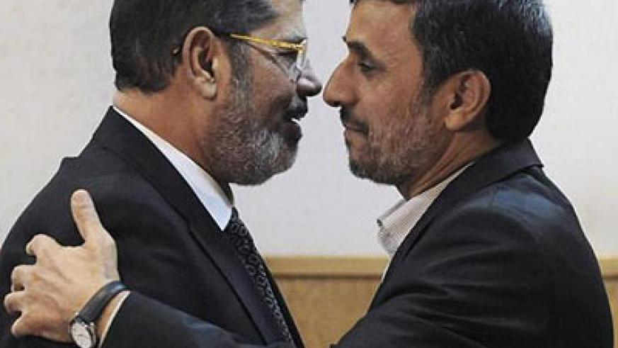 Morsi (L) stands accused of conspiring with foreign powers, Palestinian group Hamas and Iran. Here, he was with then Iran President Mahmoud Ahmadinejad. Net photo.
