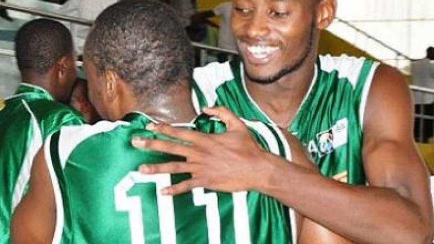 Espoir's forward Olivier Shyaka, right, hugs a teammate after a league game last season. Shyaka scored 30 points as Espoir won the opening game yesterday. File.